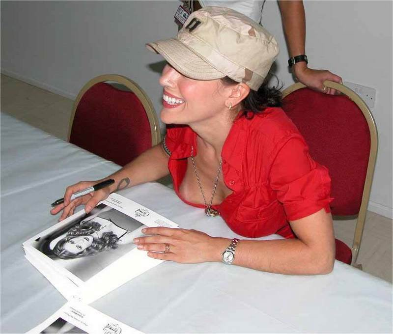 Alyssa Milano Giving People At An Autograph Signing A Show NSFW