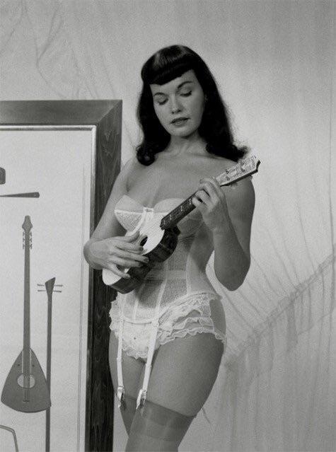 Bettie Page Playing A Ukulele NSF