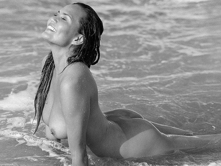 Chrissy Teigen Nude On The Surf NSFW